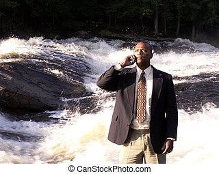 natures calling - business man in a suit with cell phone...