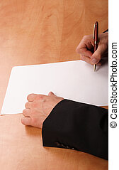 signing contract - Hands signing blank paper at the desk