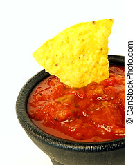 chips and salsa - tortilla chip in a basket of salsa