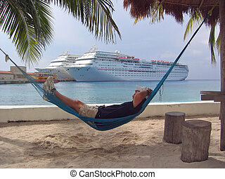 Hammock Relaxation - A man rests in a hammock while cruise...