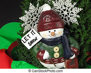 Let it Snow - Snow man figure with let it snow sign on...