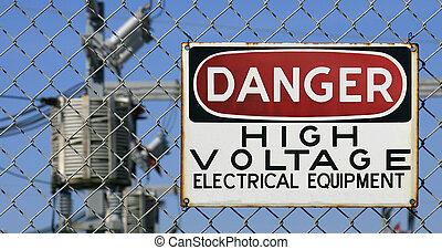 Danger High Voltage - Danger Sign hanging on a fence. White,...