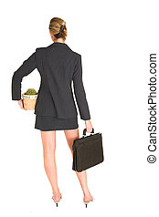 Laura Hopton 17 - Business woman standing, holding suitcase...