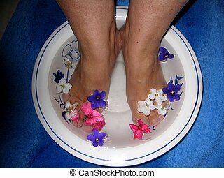 Foot bath - Woman taking a foot bath