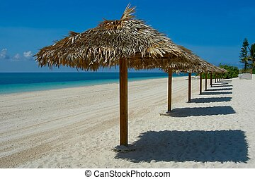 Beach umbrellas in Freeport beach, Bahamas islands