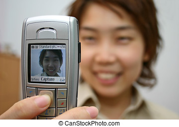 Mobile Camera Phone - Happy young adult with mobile camera...