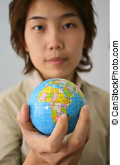 Earth in my hand! - Asian female holding a globe.