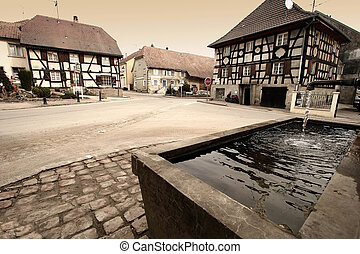 alsacian village - in a small alsacian village in france,...