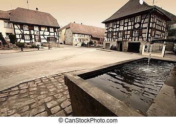 alsacian village - in a small alsacian village in france,...