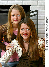 Beautiful Sisters by Fireplace Closeup - A closeup portrait...