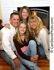 Happy Family At Home 2 - An attractive, happy family sitting...