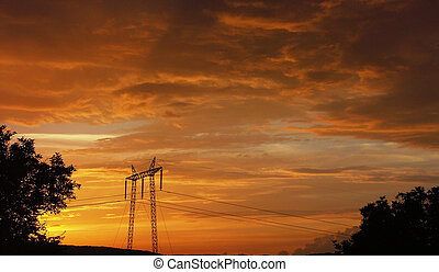 Electric sunset - Spectacular sunset with silhouette of high...