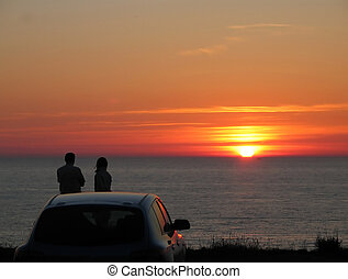 date on a sunset - man and woman are watching a sunset
