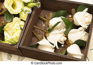 Wedding 16 - Wedding - corsages in a brown wooden holder