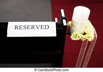 Wedding #27 - Reserved sign on chapel bench