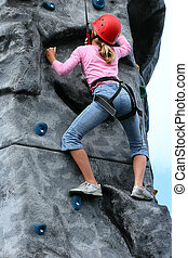 Powerful Position - A young girl wearing a saftey harness...