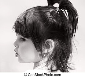 Pouting Lips and Pigtails - Little girl with a pouting mouth...