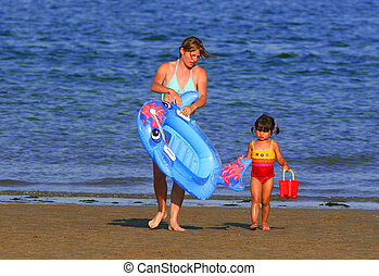 Mother and Daughter - Mother and daughter at the beach on...