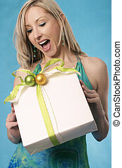 Gifts bring a smile - A womans expression of delight of...