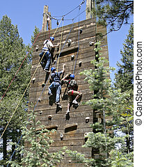 Climbing Wall - Three climbers in a teambuilding exercies...