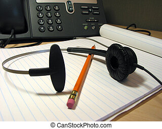 Customer support 4 - Headset, pencil and notepad on the...