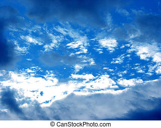 Opening in the clouds - Bright blue sky with opening in the...