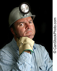 Coal Miner Portrait 2 - A portrait of a coal miner against a...