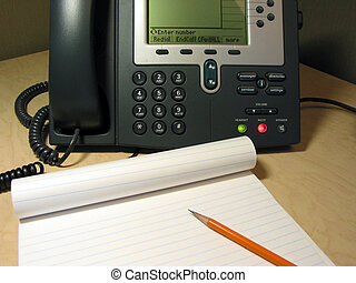 Customer support 5 - IP phone on the desk in the office with...
