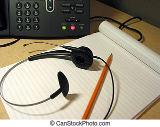 Customer support 7 - Headset, pencil and notepad on the...