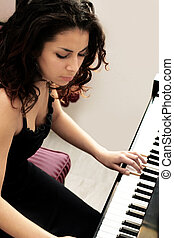 Beautiful pianist - Beautiful middle eastern girl playing...
