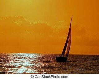 sailing at sunset - navigating at Atlantic Ocean