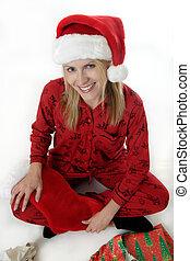 Christmas Morning - Cute woman in Santa hat on Christmas...