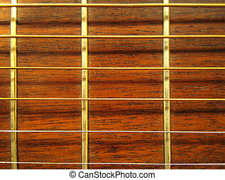 Guitar - Pattern - Detail of acoustic guitar fretboard