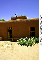 Pueblo Style - Ancient adobe ranch building is an example of...