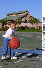 Hit That Ball - Boy dribbling basket ball