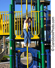 Coming Down - Boy sliding down at playground