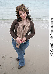 Young Woman on Beach - Young woman outdoors in the fall on...
