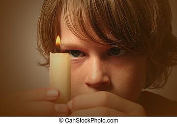 Fire - boy holding a burning candle