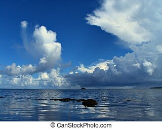 Tropical cloudscape over the sea - Exotic seascape and...
