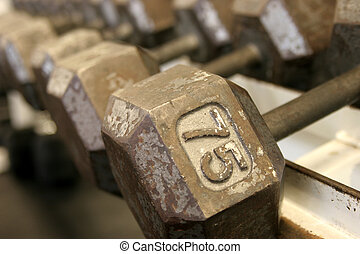 75 pound dumbbell - Row of dumbbells blurring into the...