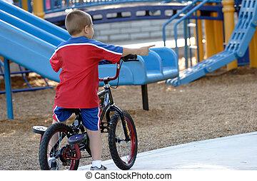 kid riding his bike - No more training wheels
