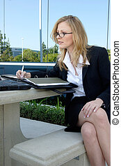 working outside - Business woman working outside office...