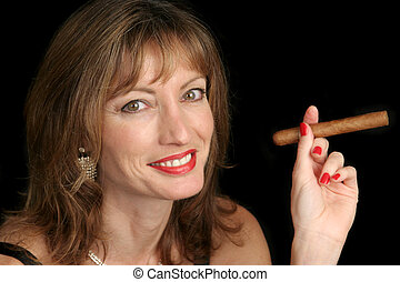 Cute Woman Smoking Cigar - A cute woman smoking a big cigar