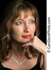 Elegant Beauty - Wistful - A beautiful woman in an evening...