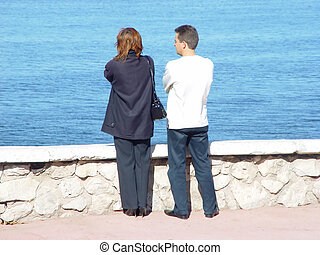 couple looking on the water