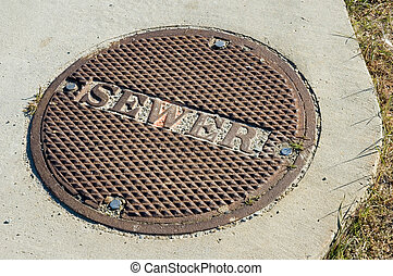 Sewer Manhole Cover - Bolted down sewer manhole cover in a...