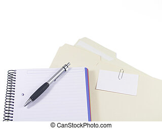 Client files - a pen, blank notebook and folders with...