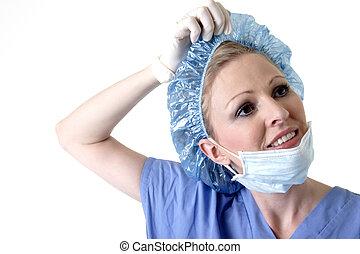taking off hair net - Surgeon taking off hair net
