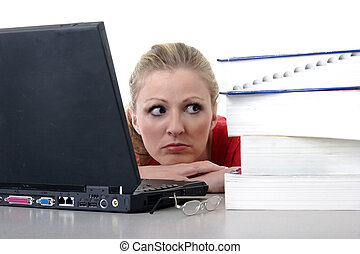Girl studying on laptop