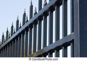 Steel gate - A steel gate making a striking pattern against...